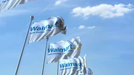walmart : Waving flags with Walmart logo against sky, seamless loop.