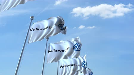 eixo : Waving flags with Volkswagen logo against sky, seamless loop.