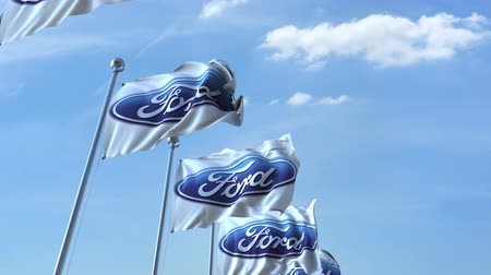 eixo : Waving flags with Ford logo against sky, seamless loop. Stock Footage