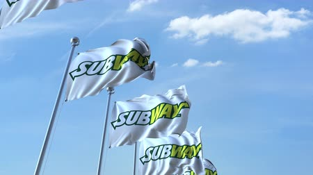 eixo : Waving flags with Subway logo against sky, seamless loop.