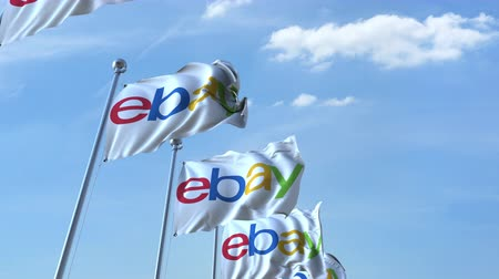 ebay : Waving flags with Ebay logo against sky, seamless loop.