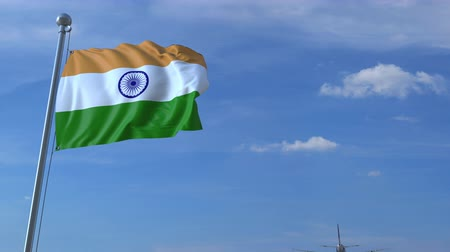 bandeira : Commercial airplane landing behind waving Indian flag. Travel to India conceptual animation