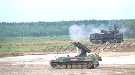 отскок : MOSCOW REGION, RUSSIA - AUGUST 25, 2017. Slow motion shot of shooting Russian anti-aircraft self-propelled system Pantsir-S1 and SA-13 Gopher on the foreground