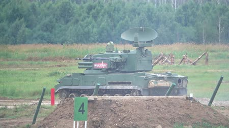 silahlar : MOSCOW REGION, RUSSIA - AUGUST 25, 2017. Slow motion shot of moving Russian self-propelled anti-aircraft weapon 2K22 Tunguska