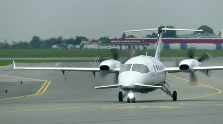 pólos : WARSAW, POLAND - SEPTEMBER 8, 2017. Piaggio P-180 Avanti turboprop airplane taxiing at the Chopin international airport Stock Footage