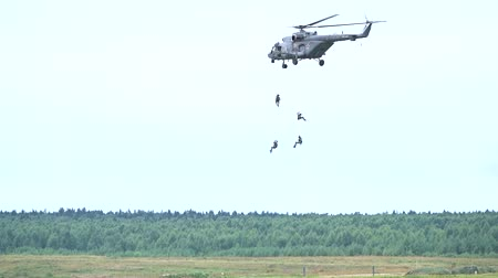 mi : MOSCOW REGION, RUSSIA - AUGUST 25, 2017. Slow motion shot of Russian special force officers disembarking from Mil Mi-8 helicopter