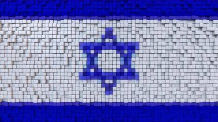 dalgalanan : Stylized mosaic flag of Israel made of moving pixels, seamless loop motion background Stok Video