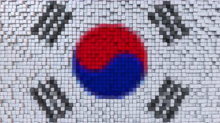 dalgalanan : Stylized mosaic flag of South Korea made of moving pixels, seamless loop motion background