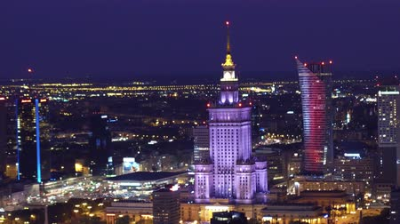 stalinist : WARSAW, POLAND - AUGUST 26, 2017. Palace of Culture and Science establishing aerial night shot