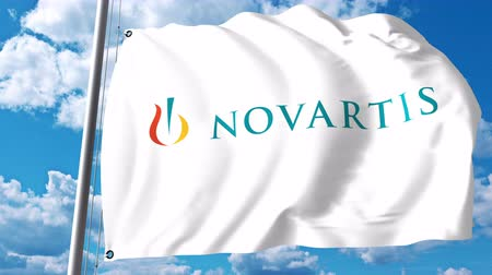 редакционный : Waving flag with Novartis logo against clouds and sky. 4K editorial animation