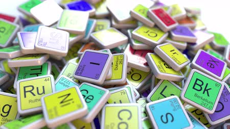 rhodium : Rhodium Rh block on the pile of periodic table of the chemical elements blocks. Chemistry related intro animation Stock Footage
