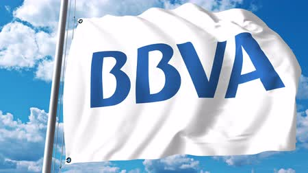vizcaya : Waving flag with Banco Bilbao Vizcaya Argentaria BBVA logo against clouds and sky. 4K editorial animation Stock Footage