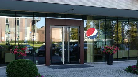 pepsico : Glass facade of a modern office building with Pepsi logo. Editorial 3D rendering
