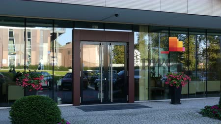 pwc : Glass facade of a modern office building with PricewaterhouseCoopers PwC logo. Editorial 3D rendering