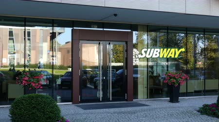 franczyza : Glass facade of a modern office building with Subway logo. Editorial 3D rendering