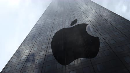 apple headquarter : Apple Inc. logo on a skyscraper facade reflecting clouds, time lapse. Editorial 3D rendering