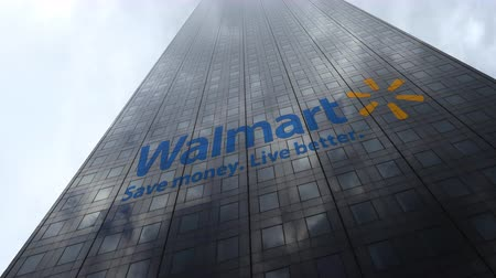 walmart : Walmart logo on a skyscraper facade reflecting clouds, time lapse. Editorial 3D rendering Stock Footage