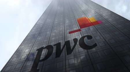 pwc : PricewaterhouseCoopers PwC logo on a skyscraper facade reflecting clouds, time lapse. Editorial 3D rendering Stock Footage