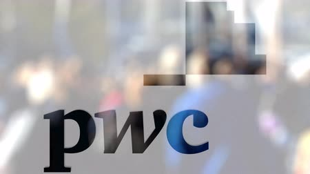 pwc : PricewaterhouseCoopers PwC logo on a glass against blurred crowd on the steet. Editorial 3D rendering
