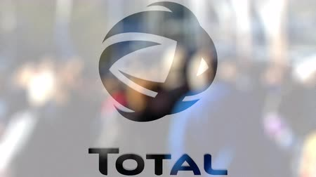 refining : Total S.A. logo on a glass against blurred crowd on the steet. Editorial 3D rendering Stock Footage