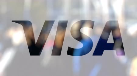 visa : Visa Inc. logo on a glass against blurred crowd on the steet. Editorial 3D rendering