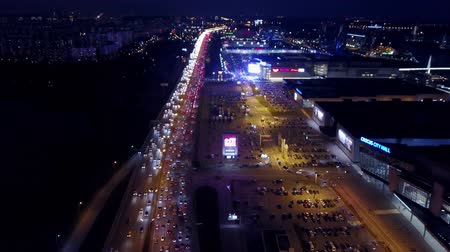 krokus : MOSCOW, RUSSIA - NOVEMBER 18, 2017. Aerial view of the Crocus Expo International Exhibition Center parking and traffic jam on MKAD ring road in the evening rush hour