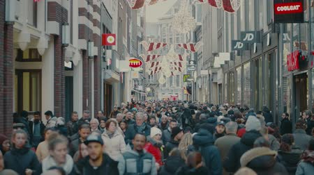 mcdonalds : AMSTERDAM, THE NETHERLANDS - DECEMBER 25, 2017. Overhead steadicam shot of crowded tourist street in city center