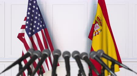 spaniard : Flags of the USA and Spain at international meeting or negotiations press conference
