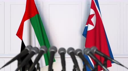dprk : Flags of the UAE and North Korea at international meeting or negotiations press conference Stock Footage