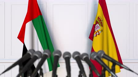 spaniard : Flags of the UAE and Spain at international meeting or negotiations press conference