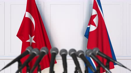 north korean flag : Flags of Turkey and North Korea at international meeting or negotiations press conference