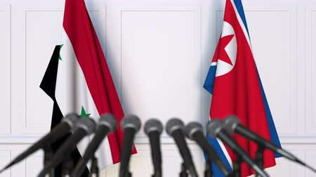 north korean flag : Flags of Syria and North Korea at international meeting or negotiations press conference
