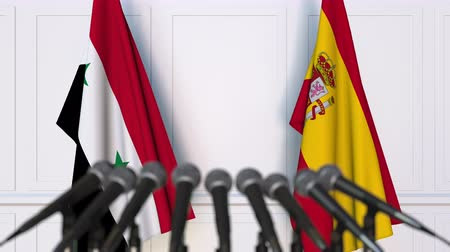 spaniard : Flags of Syria and Spain at international meeting or negotiations press conference