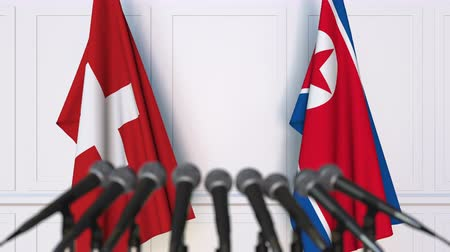 north korean flag : Flags of Switzerland and North Korea at international meeting or negotiations press conference