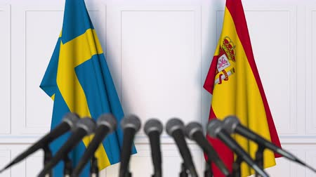 spaniard : Flags of Sweden and Spain at international meeting or negotiations press conference