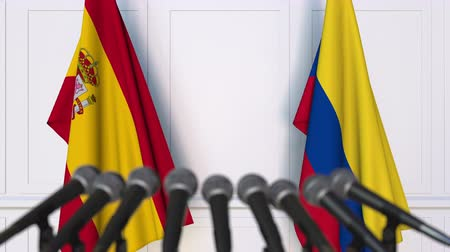 spaniard : Flags of Spain and Colombia at international meeting or negotiations press conference