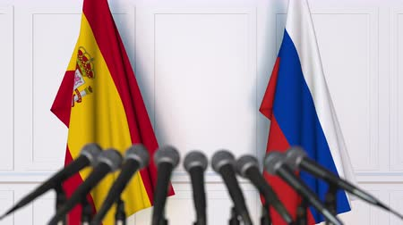 spaniard : Flags of Spain and Russia at international meeting or negotiations press conference Stock Footage