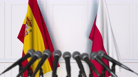 spaniard : Flags of Spain and Poland at international meeting or negotiations press conference