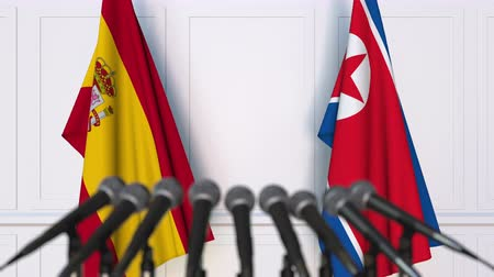 dprk : Flags of Spain and North Korea at international meeting or negotiations press conference Stock Footage