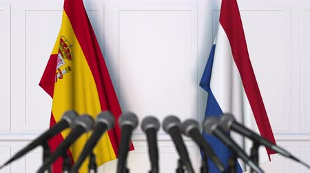 spaniard : Flags of Spain and Netherlands at international meeting or negotiations press conference