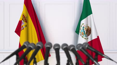 spaniard : Flags of Spain and Mexico at international meeting or negotiations press conference Stock Footage