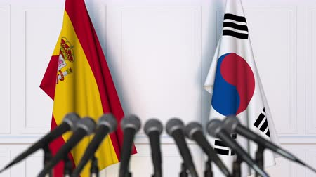 spaniard : Flags of Spain and Korea at international meeting or negotiations press conference