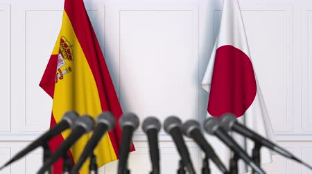 spaniard : Flags of Spain and Japan at international meeting or negotiations press conference