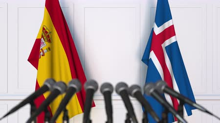 spaniard : Flags of Spain and Iceland at international meeting or negotiations press conference Stock Footage