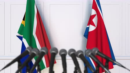 dprk : Flags of South Africa and North Korea at international meeting or negotiations press conference