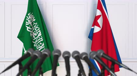 north korean flag : Flags of Saudi Arabia and North Korea at international meeting or negotiations press conference