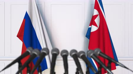 dprk : Flags of Russia and North Korea at international meeting or negotiations press conference