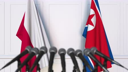 north korean flag : Flags of Poland and North Korea at international meeting or negotiations press conference