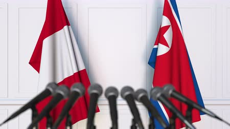 north korean flag : Flags of Peru and North Korea at international meeting or negotiations press conference Stock Footage