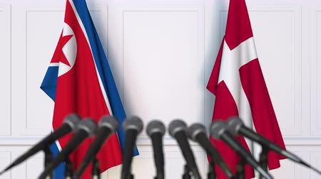 north korean flag : Flags of North Korea and Denmark at international meeting or negotiations press conference